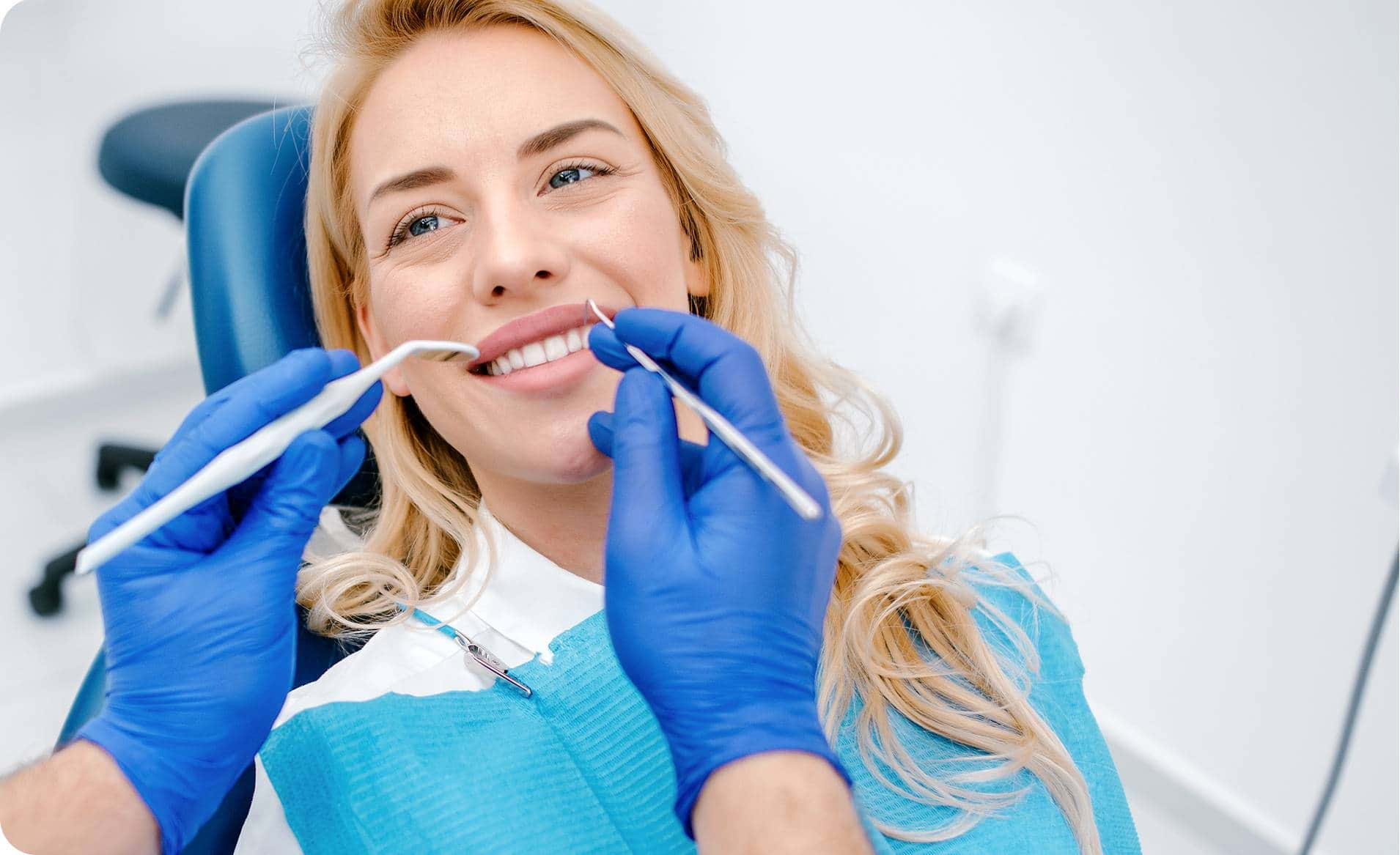 https://www.istockphoto.com/au/photo/woman-having-teeth-examining-at-dentist-gm1190798549-337690744